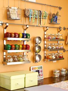 Seriously going insane with all of these crazy awesome ideas!!! How will I sleep tonight!  mount curtain or towel rods to the wall. supplies are out of drawers and off of surfaces yet still within easy reach. Baskets, bins, canisters, and magnetic strips provide homes for ribbons, stamps, paper punches, embellishments, beads, and other crafting essentials