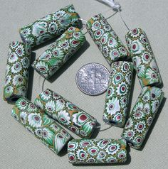 Ten large tubular Venetian millefiori beads | late 1800's to the early 1900's | Used for the African trade.