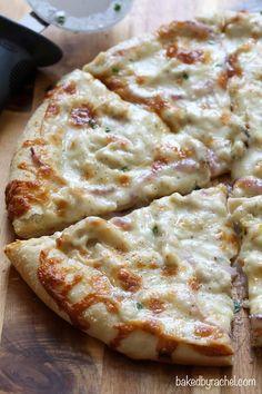 Thin crust three cheese chicken pizza with garlic white sauce recipe from @bakedbyrachel