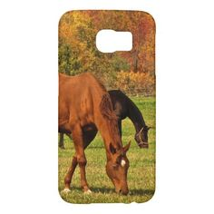 Horses in Autumn Samsung Galaxy S6 Cases. This Samsung Galaxy S6 case features fine art photography of a lovely rural autumn landscape with horses grazing the green grass. A hill looms behind them in glorious fall foliage colors of red, orange, gold, yellow, brown and green.
