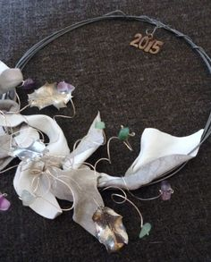 2015 charm - oxidized wire wreath with semi-precious stones, steel cast leaves from real plant and light grey leather