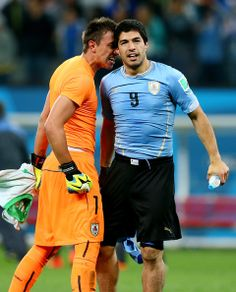 Fernando Muslera and Luis Suarez of Uruguay celebrate a 2-1 victory over England in the 2014 FIFA World Cup Brazil Group D match between Uru...