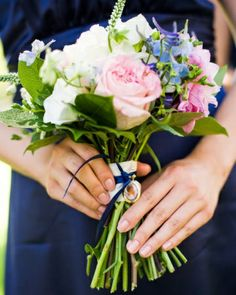 Like the pale pink roses with deep blue accent in bouquet.