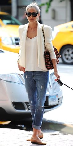 Olivia Palermo cleverly coupled distressed denim with a cream Rebecca Minkoff blazer that she styled with a colorful Mulberry bag and nude flats.