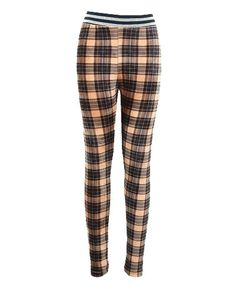 I'm not supposed to like velvet plaid leggings--but they're British, and I can't help it.
