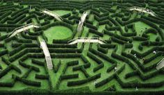 Maze at Thoiry Park - Thoiry Park includes the Château of Thoiry, a zoo, and a botanical garden that opened to the public in 1965 in the village of Thoiry, France. There are 2,300 meters of yew hedge walkways and nine bridges.