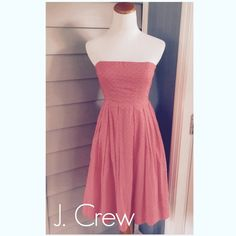 J. Crew coral strapless dress In fantastic shape!  Beautiful.  Swiss dots, gorgeous coral color.  Zips up the back.  Has straps inside to keep dress for slipping. J. Crew Dresses Strapless