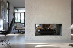 Love these double sided fireplaces. Had one in my childhood home.