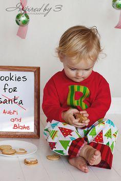Parker holding glass of milk, Lorelei holding a cookie?  Wearing santa's little helper shirts?