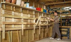 work bench out of pallets | Here's a versatile garage workbench that folds up into the walls for ...
