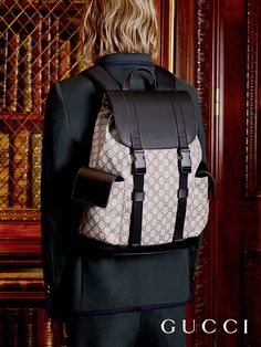 Softly constructed from GG motif fabric and black leather, a men's backpack from Gucci Cruise 2017 by Alessandro Michele.