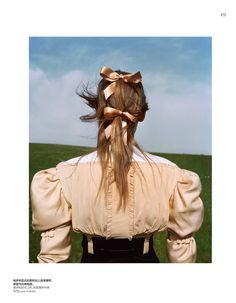 Alexandra Elizabeth wears her hair in ribbons