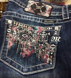 Style JP8578B Miss Me Boot Cut Jean Dark wash with light washing. Featuring a color mix of rusts and teals to create an aztec pattern on the back pockets. Pockets are accented with sequins, rhinestone