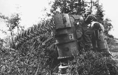 A knocked-out M4 Sherman tank knocked out makes a convenient observation post for a Waffen-SS trooper near Caen shortly after D-Day (June 1944).