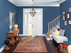 This classic blue color is a fresh way to bring in a timeless shade that is versatile and pairs with a variety of styles. Balance this bold wall color with crisp, white trim and white architectural details.Brought to you by The Paint Studio at Ace. (=)