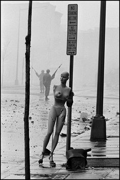 Burt Glinn - Aftermath of the riots the morning after the assassination of Martin Luther King JR., leader of the Civil Rights Movement, Washington D.C. 1968. From Burt Glinn - Political Moments