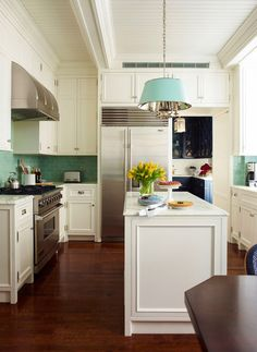 :: Ashley Whittaker Design :: Lots of ideas here for dressing up inexpensive kitchen cabinets MHD