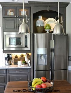 Open gray cabinets above the refrigerator is perfect for showcasing special pieces.