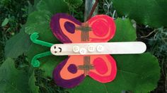 Butterfly popsicle stick art project created by Washington, DC Girl Scout Brownie troop.