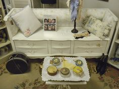 Repurposed dresser made into tufted bench, with lower drawers intact.