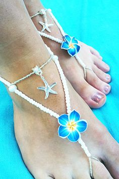 KALTRINA - Blue Plumeria and White Pearl Bridal Barefoot Sandals. $30.00, via Etsy.
