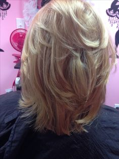 Ash blonde color with a very heavy layered haircut.