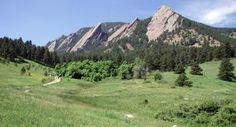 The iconic Flatiron mountains rise above Boulder in the spring - Boulder, CO