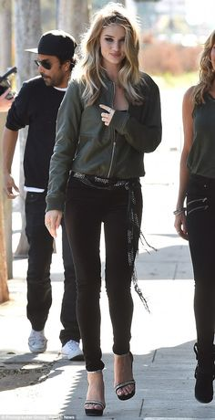 Stunning: Rosie Huntington-Whiteley cut a flawless and immaculate figure on Wednesday as s...