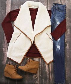 We're all about cozy knits this fall! Shop this sherpa vest and more online at Glik's!