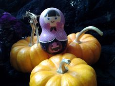 my Halloween decor 2012,, the doll and these mini pumpkins were just perfect match in color