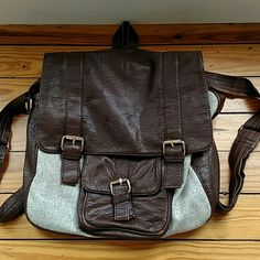 """Urban Outfitters backpack Brown leather and heather grey fabric backpack with adjustable straps. 14"""" x 12"""" x 5"""". Leather shows some signs of wear as seen in the photo. Urban Outfitters Bags Backpacks"""
