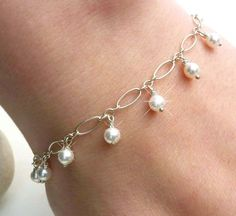 A delicious bridal white pearl charm bracelet in sterling silver. Handmade white pearl wedding jewelry by creativityjewellery. * Snow White