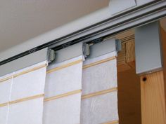 """Close-up of IKEA's 3-rail KVARTAL system with """"Anno Amorf"""" panel curtains"""
