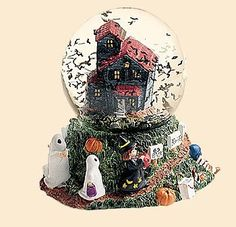 Halloween Musical Snow Globe - Want to play some creepy music with this Halloween snow globe?