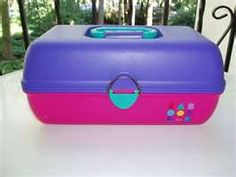 Caboodles!   @Stephanie Henninger the one I have now is all pink, it is about the same size as they were back then!!  I love it, especially for travel...just grab and go! ;)