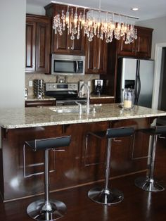 """Adding a more modern granite counter and """"funky"""" light above it could modernize an older kitchen."""