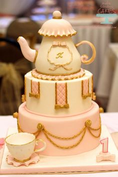 Made this teapot cake for my niece's first birthday. The theme was pink and gold princess tea party. For details of the party, go to Princess Tea Party. Princess Crown Cake, Princess Tea Party, Girls Tea Party, Tea Party Birthday, Tea Parties, Birthday Cakes, Cupcakes, Cupcake Cakes, Pillow Cakes