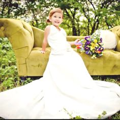Such a cute idea- have pictures of your young daughter in your wedding dress. Angel Porch of Art and Soul Photography did this with her daughter and I think it is sooo sweet. Would love to see my future little girl in my wedding dress someday! Photo credit angelporchphotography.com