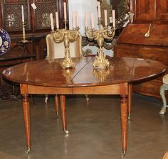 An 18th c. Directoire Cherry, Ebony and Satinwood Dining Table | From a unique collection of antique and modern dining room tables at https://www.1stdibs.com/furniture/tables/dining-room-tables/