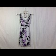 White Print Spring Dress Size XS & NWT Maurice's White Dress with Purple & Black floral print. Lovely pleats on the skirt. NWT Size XS. Maurices Dresses
