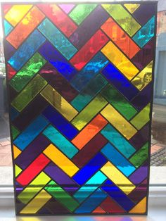 A beautiful, bespoke stained glass window made to order! This parquet design can be replicated using any scale or colour combination to fit a window of your choosing. As with all of our designs, the finished piece is created using the copper foil method and is surrounded by lead came. Please get in contact to purchase your own version of this panel or other design, we can make to most sizes and can choose colours that reflect your personal style or the decor of your home. We can also make…