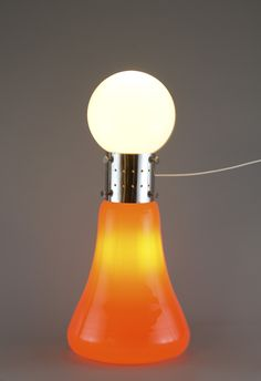 Mazzega, blown glass floor lamp by Carlo Nason, Venice Italy circa 1965   Orange blown glass floor lamp surmounted by a milk white glass sphere. Lit by two lights, one in the sphere and one in the base. The white sphere is not the original.