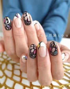 nails decorated with floral black outline