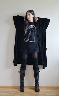 Love the layered look. Love the boots. Very comfy. Goth.