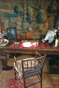 Wonderfully rich & layered desk at Vita Sackville-West's Sissinghurst - tapestry, antique rug