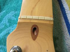 I then saw down the middle of the nut. The 2 parts of the nut are then pinched together and the nut extracted. Again, this method prevents chipping of the finish as the nut is removed.