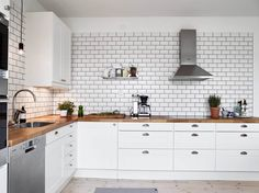 A white tiles, black grout kind of kitchen - via cocolapinedesign.com