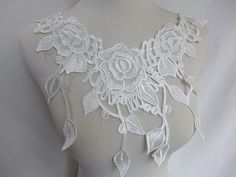 Venise Lace Applique in off white for Bridal, Jewelry Supply, Costume Design ▶ Listing is for 1 piece. ▶ Measures (approx): 13.4 x 6.9 (34 cm x 17.5 cm)  ▶ Qty: 1 pc ( Additional quantities are available.) ▶ Color: Black, off white   DIY homemade fabric, wedding, bridal dress, ribbon flowers, jewelry design, doll clothes, cake, dolls, hang adorn, bra decoration, small parts, home decor... and so on, or any other crafts you like. *******Wholesale Acceptable…