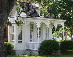 Victorian Country House…gorgeous!  Love the porch overhang woodwork. What a beautiful, quaint cottage.