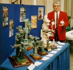 Barry is seen here with some of his models at a recent model engineering exhibition in England. Magazine cover photos of his machines adorn the blue backdrop.